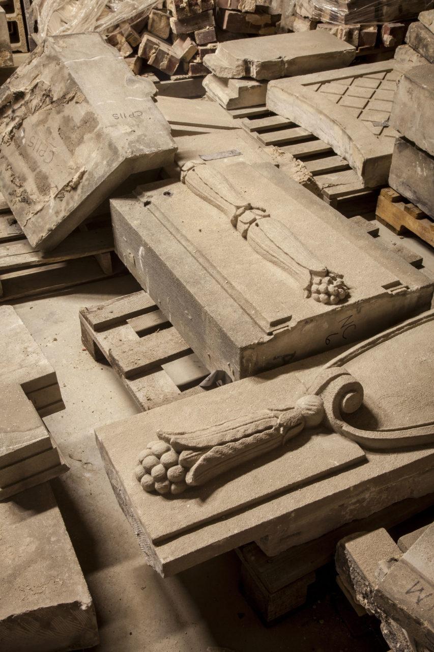 Close-up image of decorative limestone façade elements