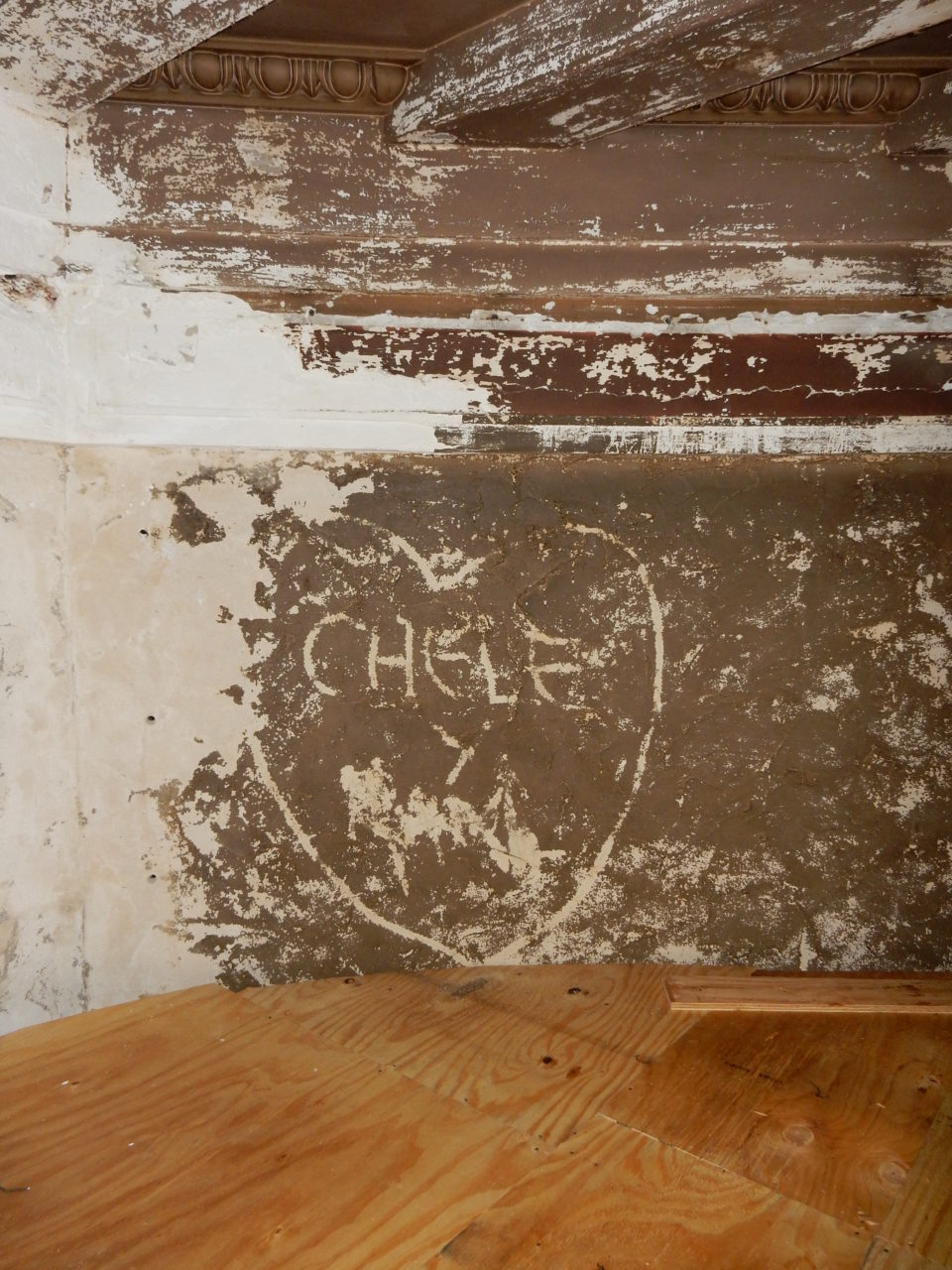 Graffiti etched into the Theatre's plaster walls