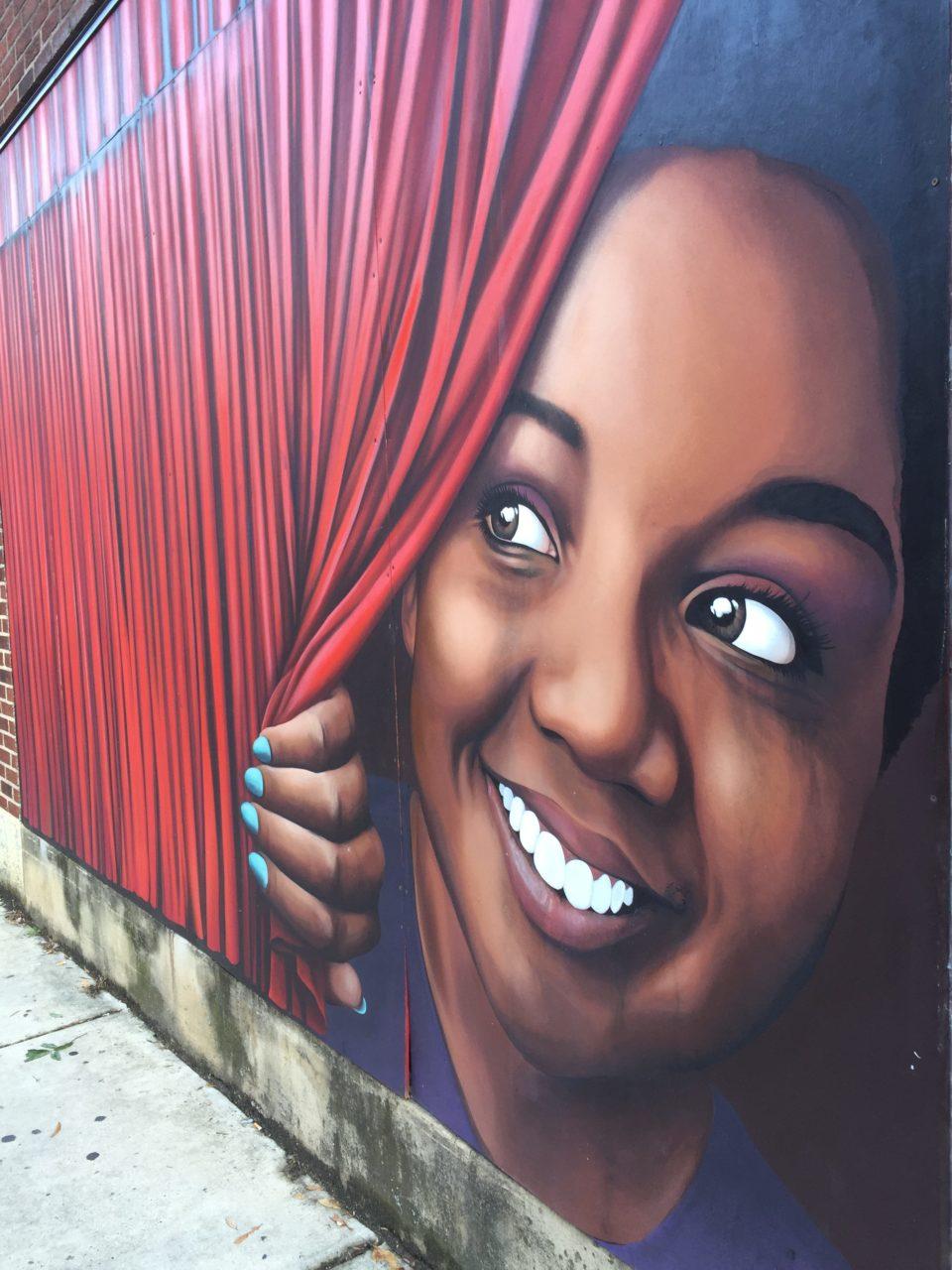A peek behind the curtain - Mural by Matt Hooker and Matt Moore